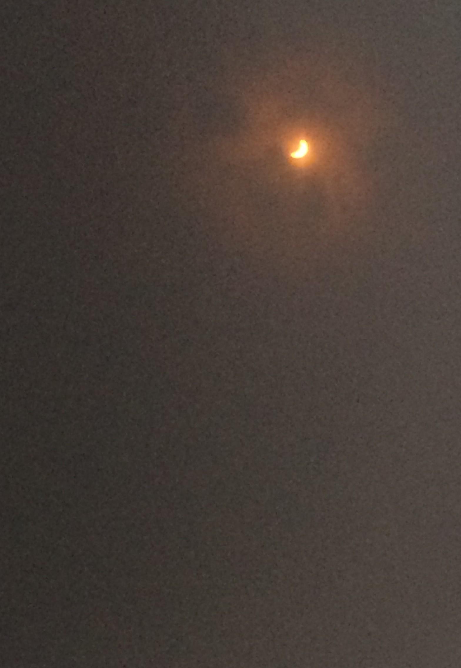 Eclipsing Sun Through Protective Lenses
